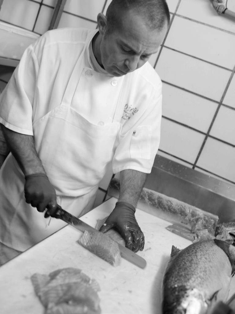 Chef Regan Reik prepares fresh seafood at Pier W Restaurant and Lounge in Cleveland, Ohio